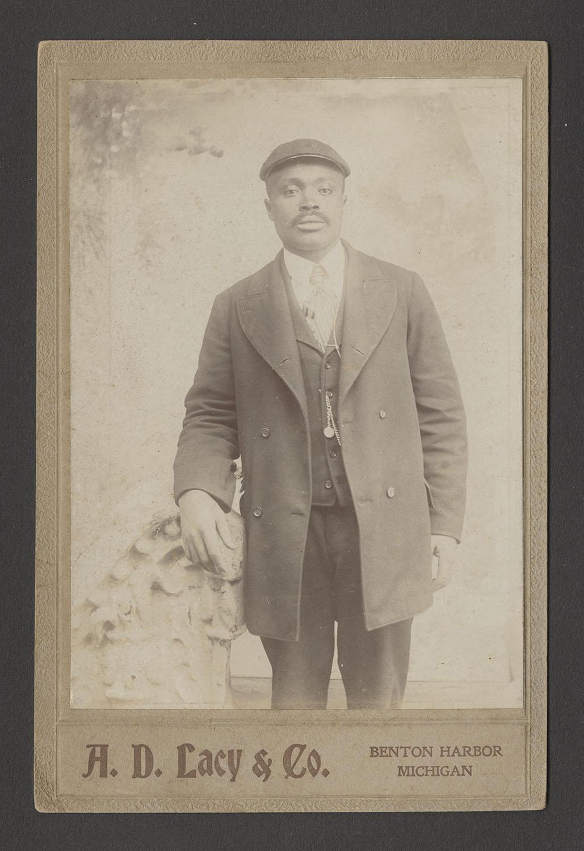 Man in pageboy hat