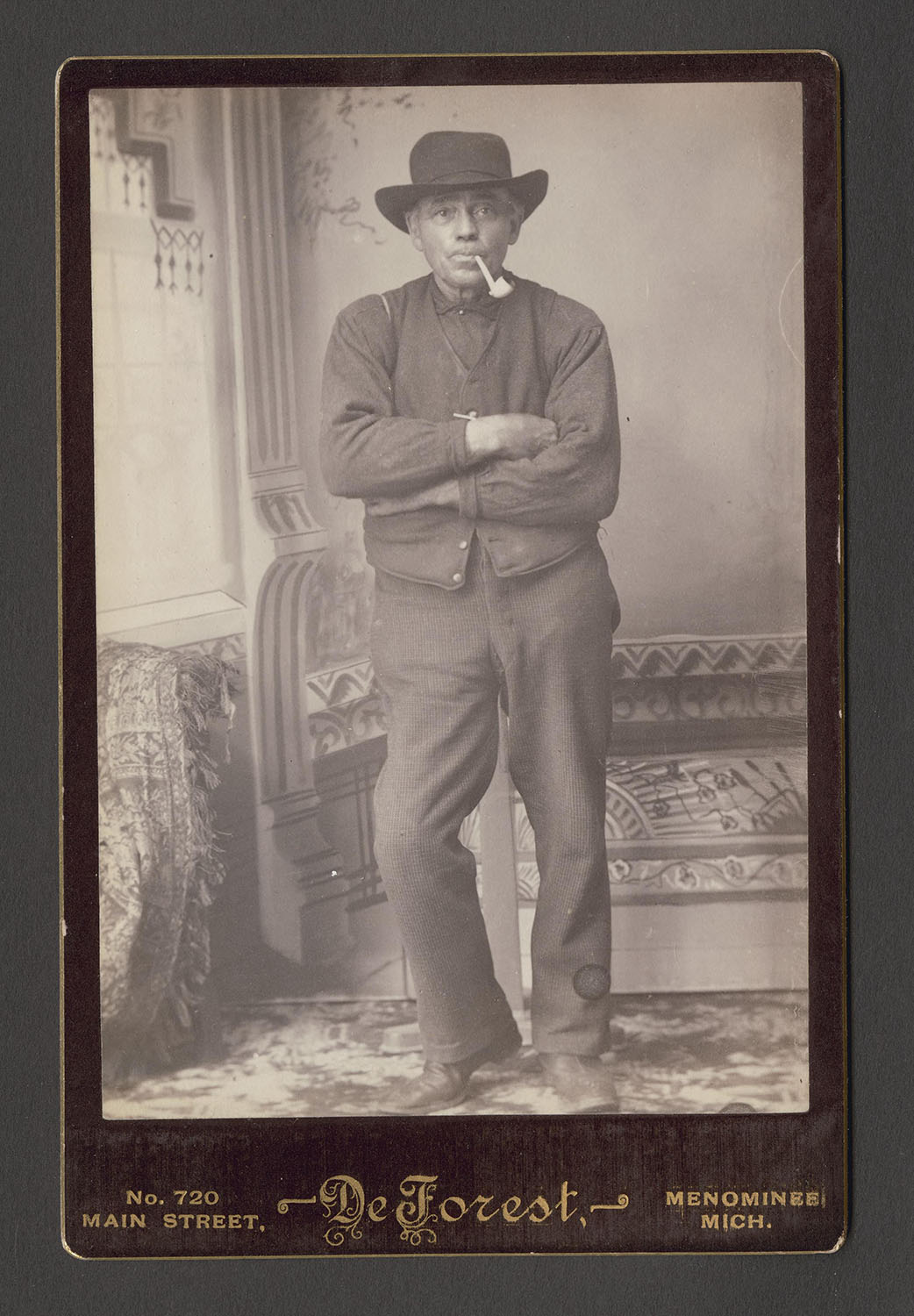 man with pipe and hat
